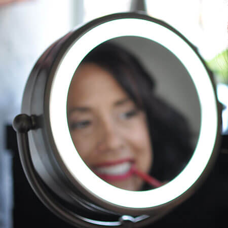 Suzanne using a beauty mirror