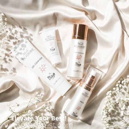 A set of anti-aging creams on a silk sheet
